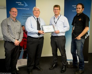 The AW Bell team awarded with their certificate by Stephen Lakotij, DIIC